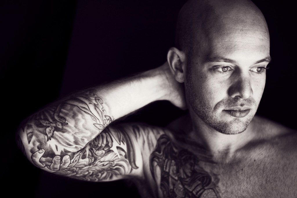 natural light modern portrait of a tattooed man in black and white